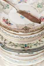 Stack of vintage plates for buffet appetizer table