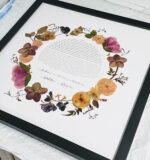 Pressed flowers surrounding the couple's ketubah.